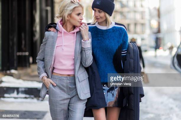 Caroline Daur wearing a grey Escada suit pink Vetements hoody and Lisa Hahnbueck wearing Canada Goose Resolute Parka Louis Vuitton RTW Mohair Knit...