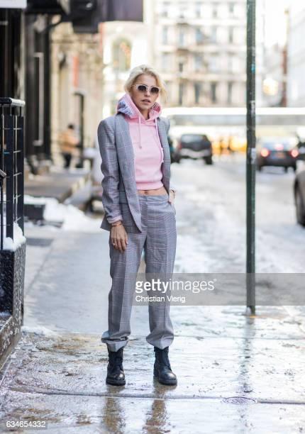 Caroline Daur wearing a grey Escada suit pink Vetements hoody on February 10 2017 in New York City