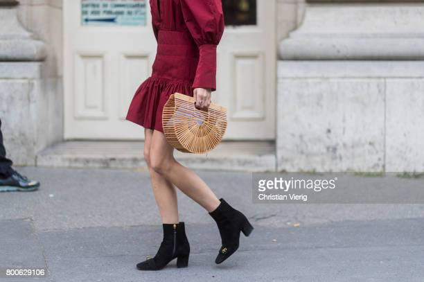 Caroline Daur wearing a red dress black boots basket bag outside Dior Homme during Paris Fashion Week Menswear Spring/Summer 2018 Day Four on June 24...