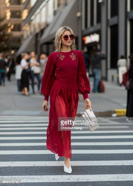 Caroline Daur wearing a red dress seen in the streets of Manhattan outside Prabal Gurung during New York Fashion Week on September 10 2017 in New...
