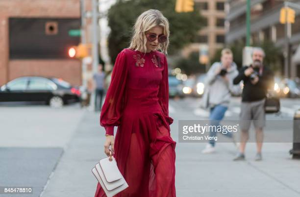 Caroline Daur wearing a red dress seen in the streets of Manhattan outside Prabal Gurung during New York Fashion Week on September 10, 2017 in New...