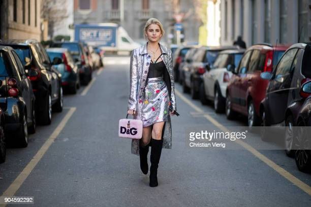Caroline Daur wearing a silver coat silver skirt black boots Dolce Gabbana bag is seen outside Dolce Gabbana during Milan Men's Fashion Week...