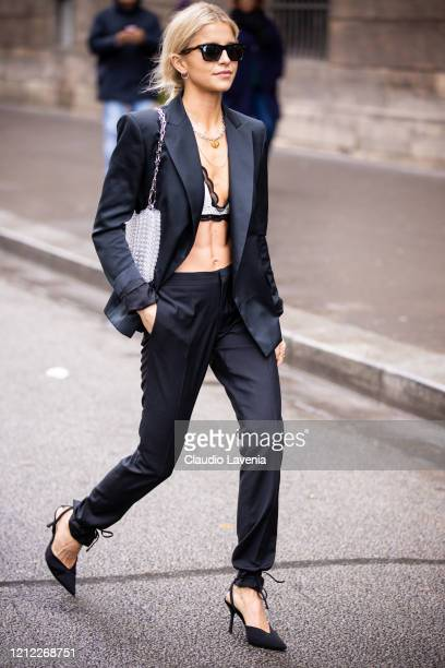 Caroline Daur, wearing a white bralette, black suit, black heels and silver bag, is seen outside Giambattista Valli, during Paris Fashion Week -...