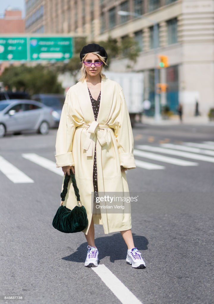 Caroline Daur wearing a yellow coat, beret seen in the streets of Manhattan outside Zimmermann during New York Fashion Week on September 11, 2017 in New York City.