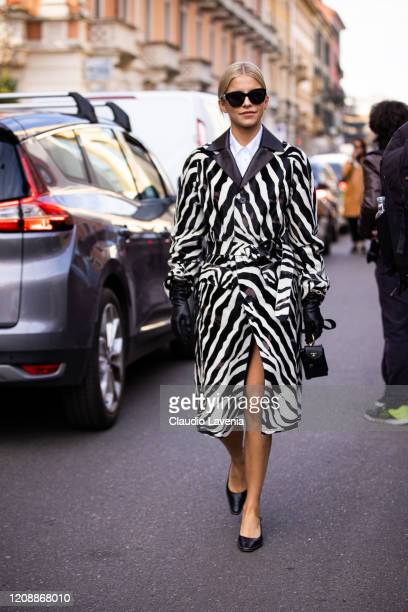 Caroline Daur, wearing a zebra print coat, black gloves, black heels and black Tod's bag is seen outside Tod's show, during Milan Fashion Week...
