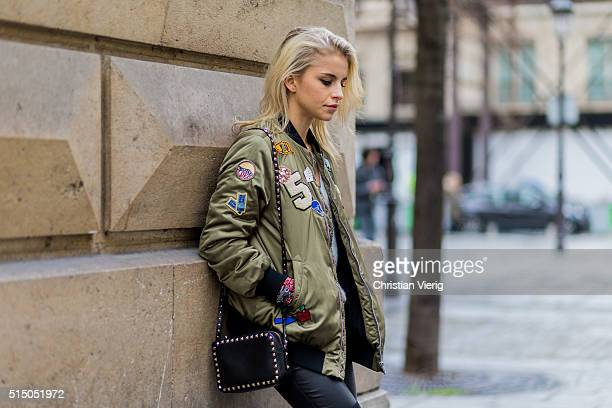 Caroline Daur wearing an olive Zara bomber jacket black Valentino bag a Rene Lezard sweater Zadig et Voltaire black pants during the Paris Fashion...