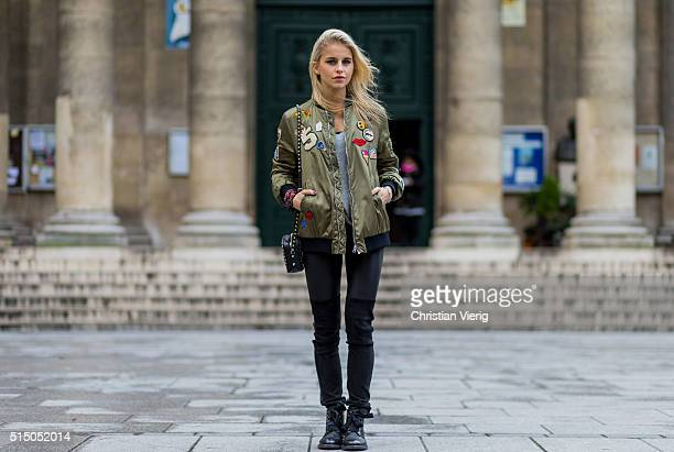 Caroline Daur wearing an olive Zara bomber jacket black Valentino bag a Rene Lezard sweater Zadig et Voltaire black boots and pants during the Paris...