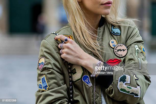 Caroline Daur wearing an olive Zara bomber jacket during the Paris Fashion Week Womenswear Fall/Winter 2016/2017 on March 9 2016 in Paris France