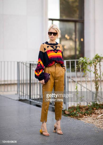 Caroline Daur wearing beige cropped pants heeled sandals knit with pattern is seen outside Sacai during Paris Fashion Week Womenswear Spring/Summer...