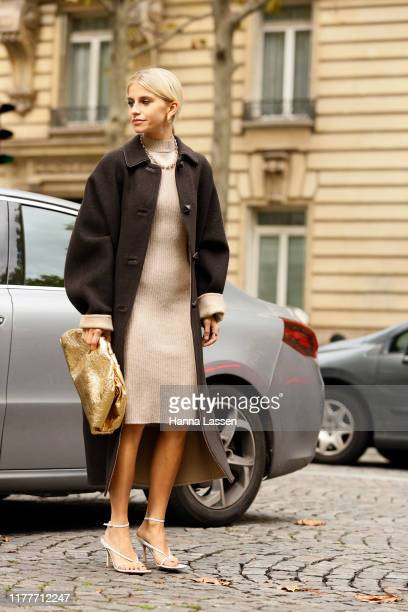 Caroline Daur wearing beige knit dress and dark brown coat outside the Altuzarra show during Womenswear Spring/Summer 2020 show Paris Fashion Week on...