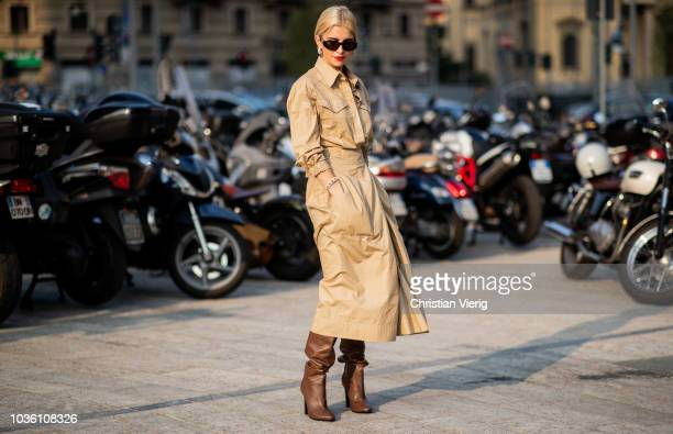 Caroline Daur wearing beige trench coat brown boots is seen outside Alberta Ferretti during Milan Fashion Week Spring/Summer 2019 on September 19...