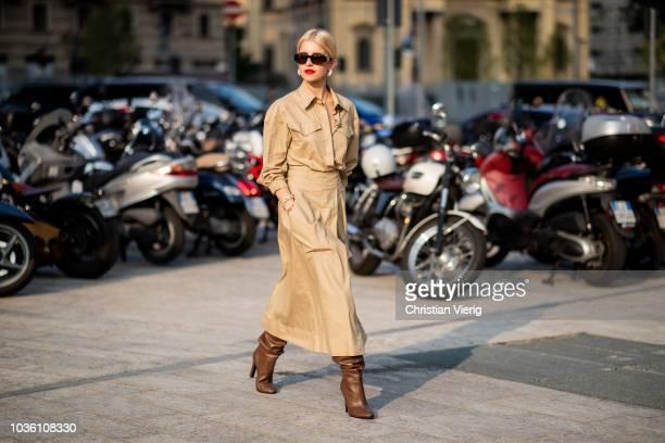 Caroline Daur wearing beige trench coat brown boots is seen outside Alberta Ferretti during Milan Fashion Week Spring/Summer 2019 on September 19...