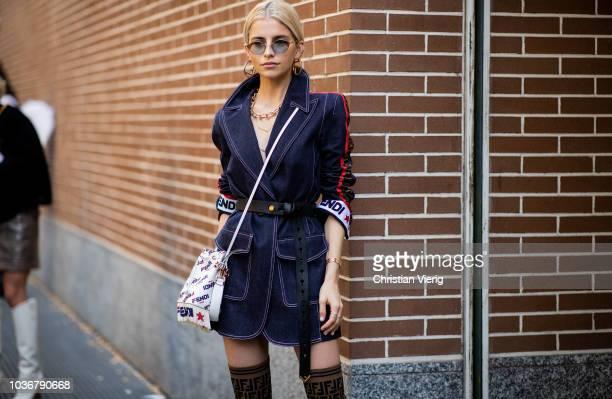 Caroline Daur wearing belted denim coat Fendi boots white Fendi bag is seen outside Fendi during Milan Fashion Week Spring/Summer 2019 on September...