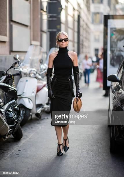 Caroline Daur wearing black top and skirt is seen outside Max Mara during Milan Fashion Week Spring/Summer 2019 on September 20 2018 in Milan Italy