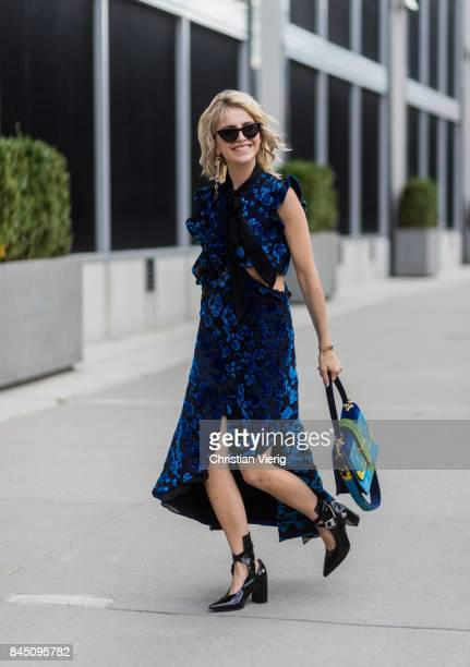 Caroline Daur wearing blue dress seen in the streets of Manhattan outside Dion Lee during New York Fashion Week on September 9 2017 in New York City