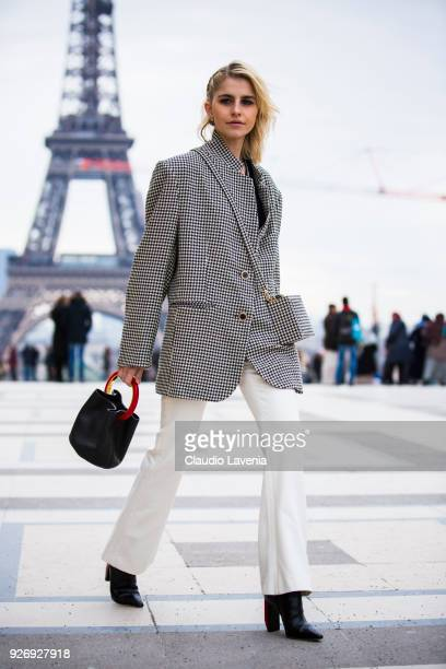 Caroline Daur wearing checked blazer jacket and black bag is seen in the streets of Paris after the Haider Ackermann show during Paris Fashion Week...