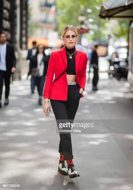 Caroline Daur wearing cropped top red blazer jacket is seen outside Dior Homme on day five of Paris Fashion Week Menswear SS19 on June 23 2018 in...