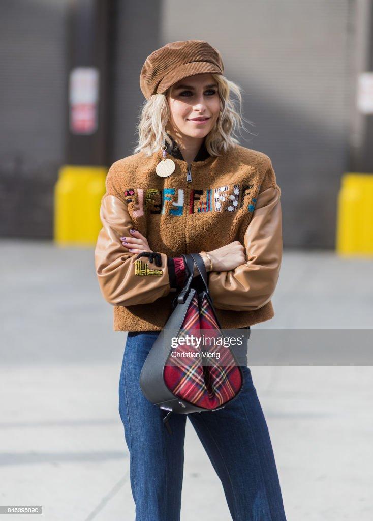 Caroline Daur wearing Fendi jacket, flat cap, Loewe bag seen in the streets of Manhattan outside Jonathan Simkhai during New York Fashion Week on September 9, 2017 in New York City.
