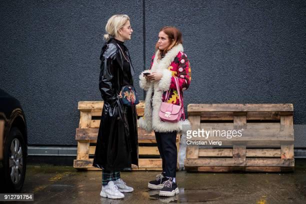 Caroline Daur wearing green checked pants black vinyl coat Gucci bag sneakers and Blanca Miro Scrimieri outside Cecilie Bahnsen during the Copenhagen...