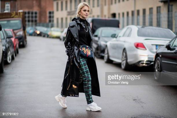 Caroline Daur wearing green checked pants black vinyl coat Gucci bag sneakers outside Cecilie Bahnsen during the Copenhagen Fashion Week...