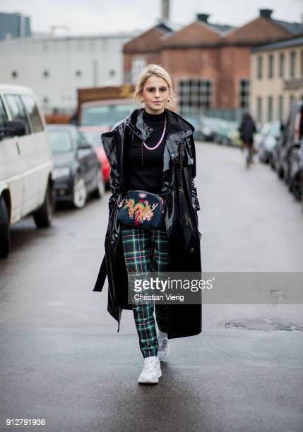 Caroline Daur wearing green checked pants black vinyl coat Gucci bag sneakers outside Cecilie Bahnsen during the Copenhagen Fashion Week...