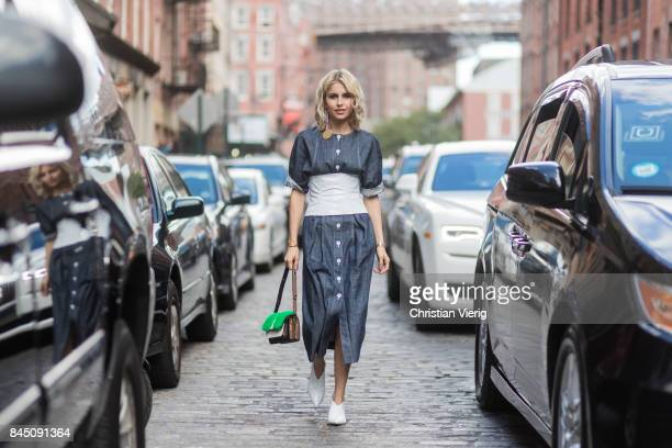 Caroline Daur wearing grey dress seen in the streets of Manhattan outside Tibi during New York Fashion Week on September 9 2017 in New York City
