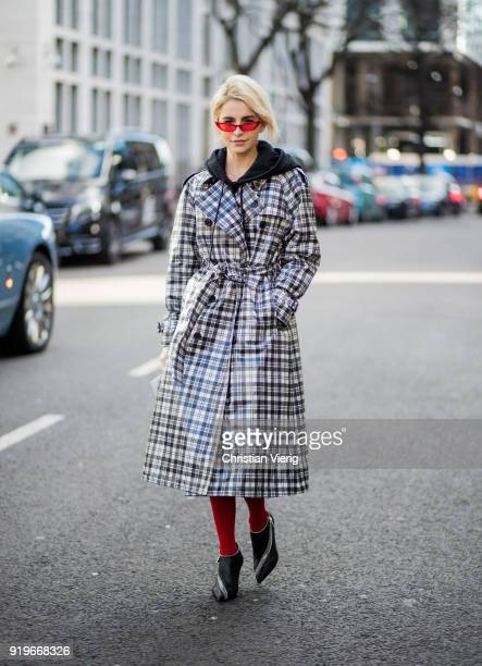 Caroline Daur wearing grey plaid Burberry coat hoodie seen outside Simone Rocha during London Fashion Week February 2018 on February 17 2018 in...