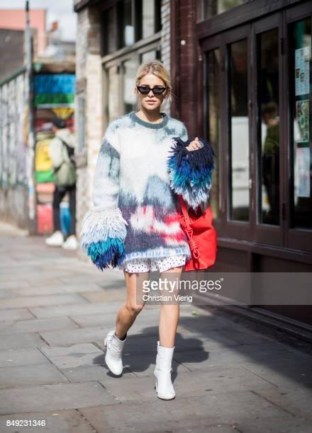 Caroline Daur wearing knit dress ankle boots red bag outside Marques Almeida during London Fashion Week September 2017 on September 18 2017 in London...