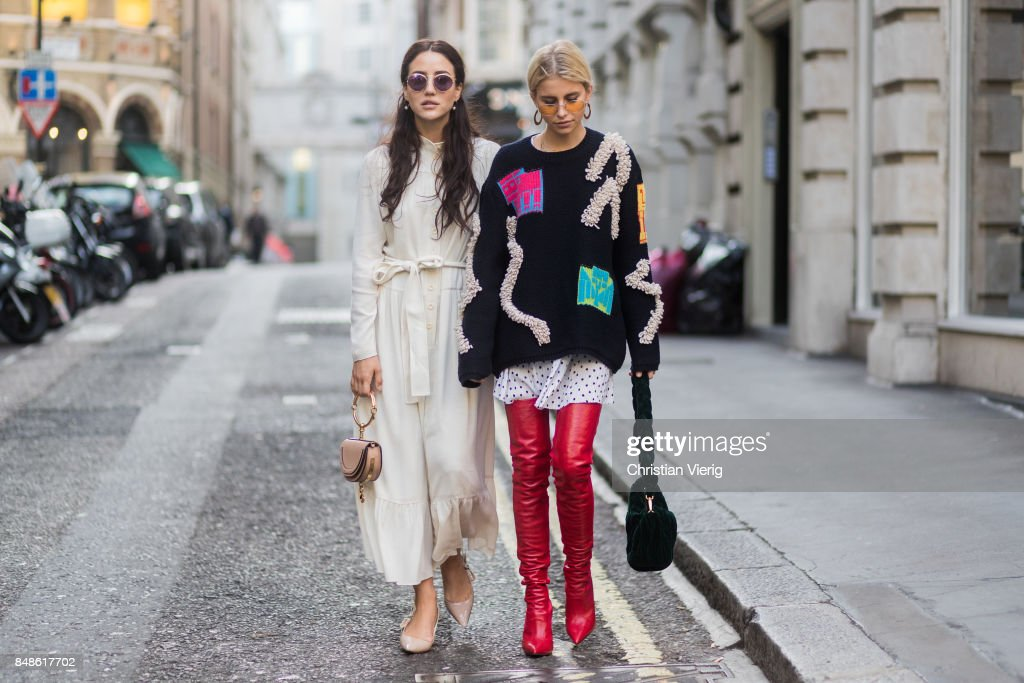 Caroline Daur wearing knit, red overknee boots and Tamara Kilic wearing white dress, Chloe bag outside Peter Pilotto during London Fashion Week September 2017 on September 17, 2017 in London, England.