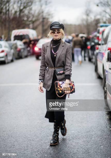 Caroline Daur wearing leather hat boots Dior bag blazer jacket is seen outside Dior Homme on January 20 2018 in Paris France