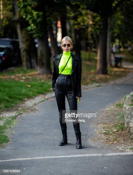 Caroline Daur wearing neon turtleneck black leather jacket and pants is seen outside Tods during Milan Fashion Week Spring/Summer 2019 on September...