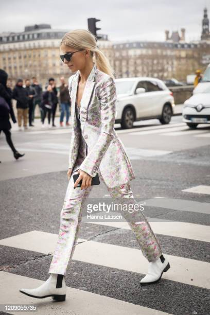 Caroline Daur wearing Paco Rabanne floral suit and white ankle boots outside the Paco Rabanne show during the Paris Fashion Week Womenswear...