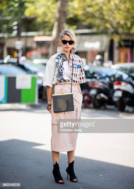Caroline Daur wearing Prada button shirt high waist skirt Prada heels is seen outside Ralph Russo on day two during Paris Fashion Week Haute Couture...