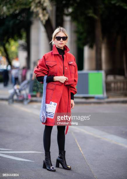 Caroline Daur wearing red coat net bag is seen outside Kenzo on day six of Paris Fashion Week Menswear SS19 on June 24 2018 in Paris France