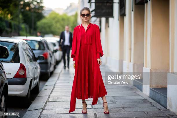 Caroline Daur wearing red dress sunglasses seen outside Valentino on day four during Paris Fashion Week Haute Couture FW18 on July 4 2018 in Paris...