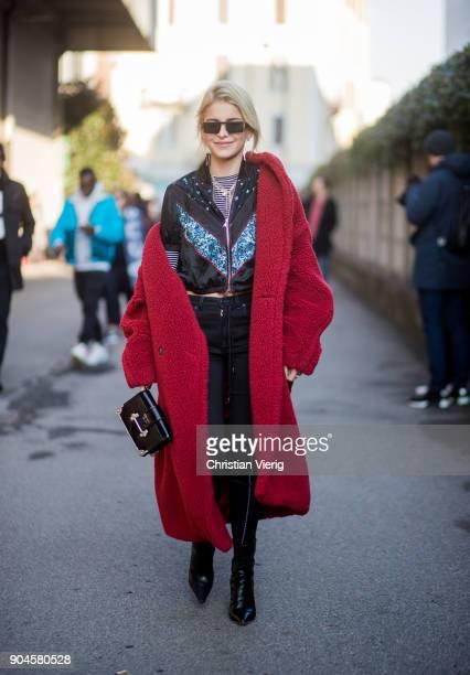 Caroline Daur wearing red teddy coat, Diesel track suit is seen outside Diesel during Milan Men's Fashion Week Fall/Winter 2018/19 on January 13,...