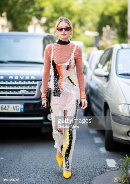 Caroline Daur wearing sheer top and orange long sleeve seen outside Acne Studios during Paris Fashion Week Haute Couture FW18 on July 1 2018 in Paris...