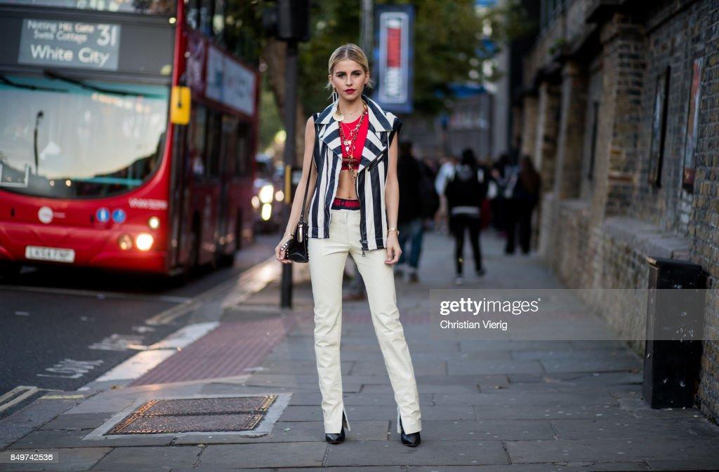 Caroline Daur wearing stripped vest, white pants outside Tommy Hilfiger during London Fashion Week September 2017 on September 19, 2017 in London, England.
