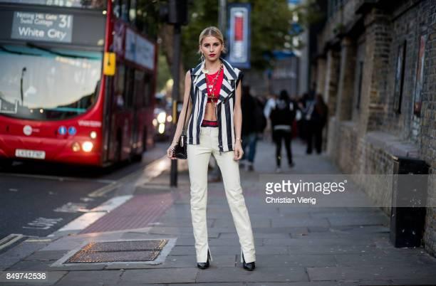 Caroline Daur wearing stripped vest white pants outside Tommy Hilfiger during London Fashion Week September 2017 on September 19 2017 in London...