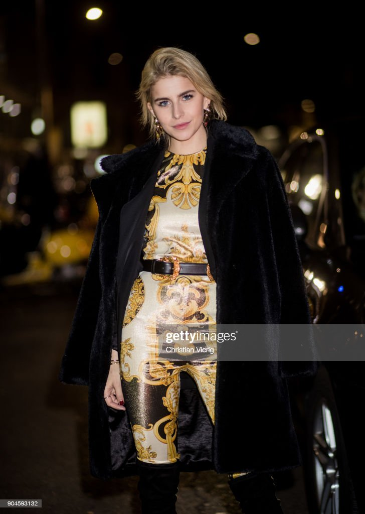 Caroline Daur wearing Versace overall is seen outside Versace during Milan Men's Fashion Week Fall/Winter 2018/19 on January 13, 2018 in Milan, Italy.