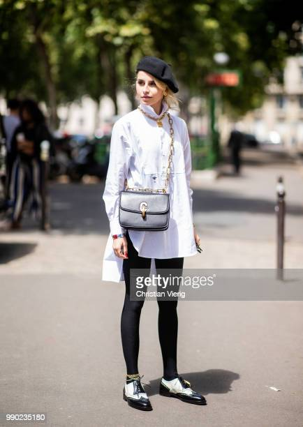 Caroline Daur wearing white button shirt black beret black leggings is seen outside Dior on day two during Paris Fashion Week Haute Couture FW18 on...