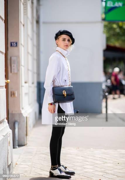 Caroline Daur wearing white button shirt, black beret, black leggings is seen outside Dior on day two during Paris Fashion Week Haute Couture FW18 on...