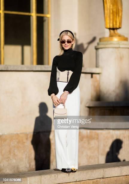 Caroline Daur wearing white pants black turtleneck is seen outside Rochas during Paris Fashion Week Womenswear Spring/Summer 2019 on September 26...