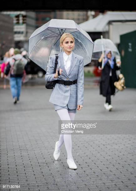 Caroline Daur wearing white tights grey belted blazer grey skirt seen outside Tibi on February 11 2018 in New York City