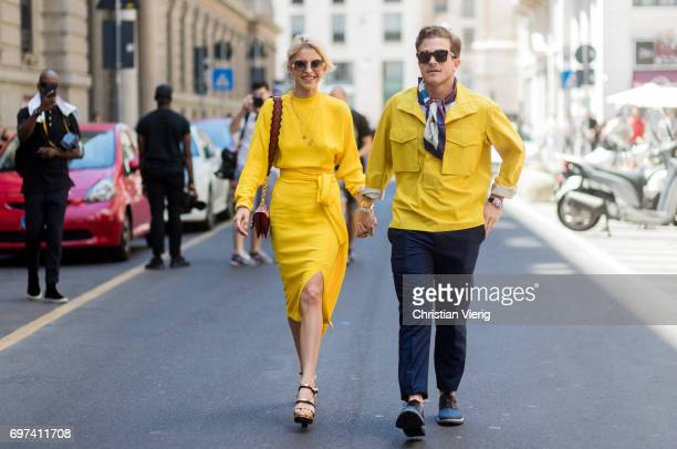 Caroline Daur wearing yellow dress and Carlo Sestini is seen outside Salvatore Ferragamo during Milan Men's Fashion Week Spring/Summer 2018 on June...