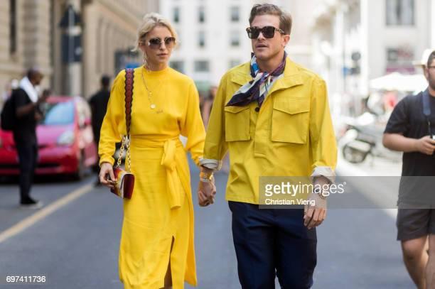 Caroline Daur wearing yellow dress and Carlo Sestini is seen outside Salvatore Ferragamo during Milan Men's Fashion Week Spring/Summer 2018 on June...