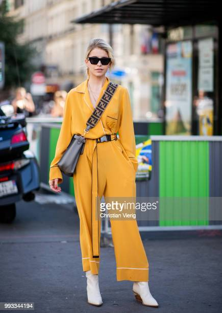 Caroline Daur wearing yellow overall Fendi bag is seen outside Fendi Couture on day four during Paris Fashion Week Haute Couture FW18 on July 4 2018...