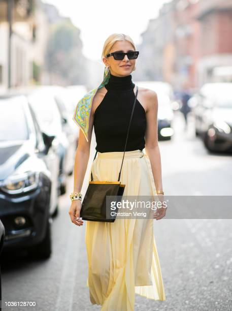 Caroline Daur wearing yellow skirt black top scarf in her hair is seen outside Jil Sander during Milan Fashion Week Spring/Summer 2019 on September...