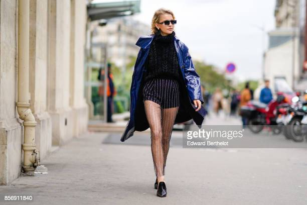 Caroline Daur wears a blue coat outside Giambattista Valli during Paris Fashion Week Womenswear Spring/Summer 2018 on October 2 2017 in Paris France