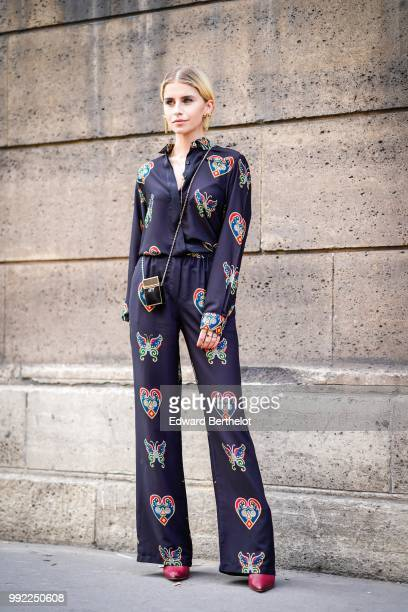 Caroline Daur wears a dar pyjama outfit with colored prints outside Elie Saab during Paris Fashion Week Haute Couture Fall Winter 2018/2019 on July 4...